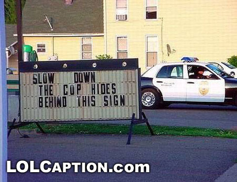 funny pictures cop hides behind this sign