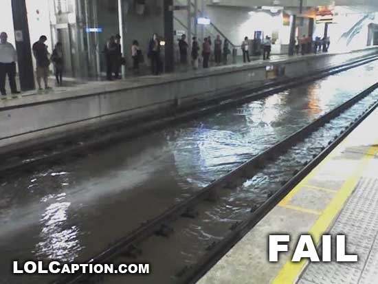 lolcaption_funny_fail_pics_water_Train_tracks_fail_Flooded