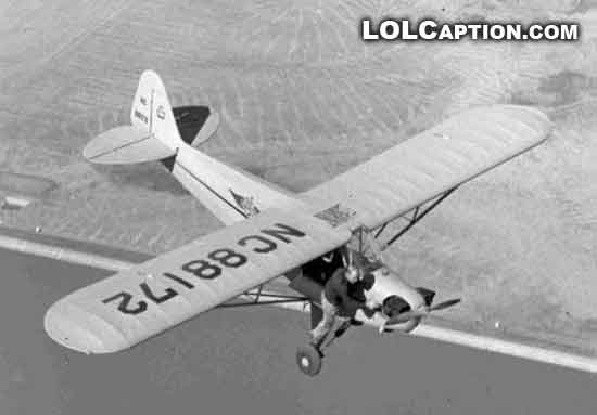 lolcaption-funny-fail-pics-climbing-out-of-a-plane-in-mid-air-pilot-flying-lol