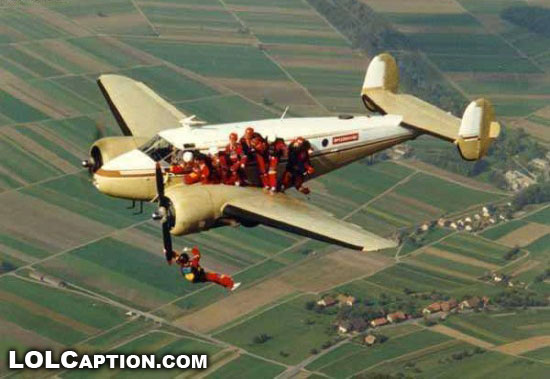 wtf-funny-photos-lolcaption-people-hanging-off-plane-propeller-skydiving