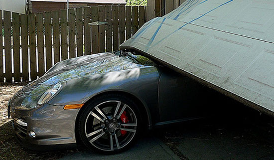 car_crash_son_launches_porsche_turbo_press_car_through_garage_door