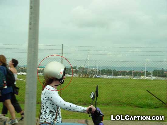 yea-its-a-woman-lolcaption-funny-fail-pics-motorbike-helmet-backwards